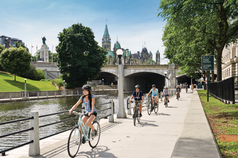 Students riding bikes along the Rideau Canal, cycling